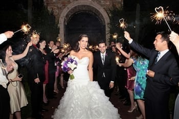 Bride walking down the aisle with sparklers
