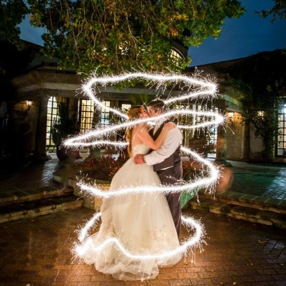 Wedding first dance with sparkler swirl photo by Michelle Jones Photography