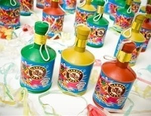Red yellow and green party poppers