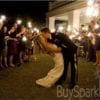 Kissing married couple with sparklers