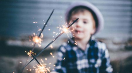 kid playing with sparklers